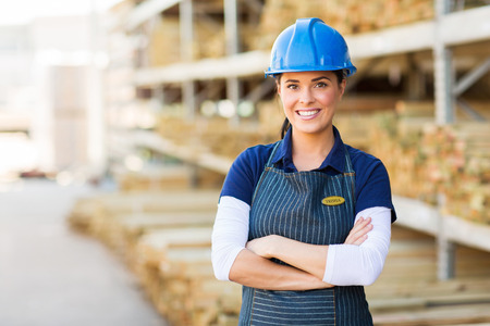 portrait of pretty female industrial worker photo