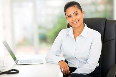 attractive young businesswoman in office looking at the camera Stock Photo