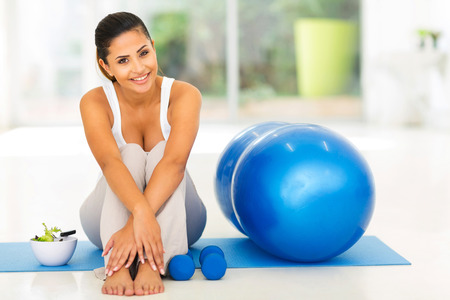 home gym: attractive fit woman with exercise ball at home