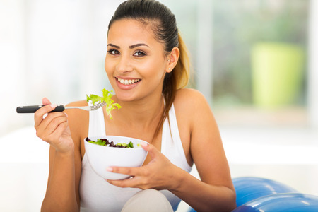 healthy young woman eating green salad Stock Photo