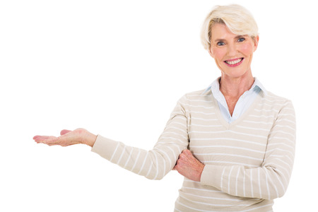 beautiful middle aged woman: beautiful middle aged woman presenting on white background Stock Photo