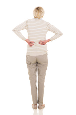 rear view of senior woman having backache isolated on white photo