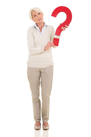 confused woman: cute mature woman holding question mark on white background
