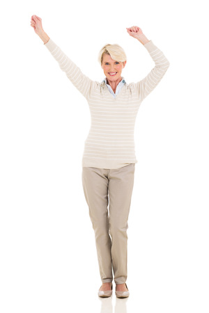 one woman: happy middle aged woman dancing on white background Stock Photo