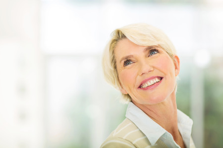 woman looking up: attractive senior woman looking up