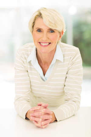 mid age: portrait of cheerful mid age woman relaxing at home Stock Photo