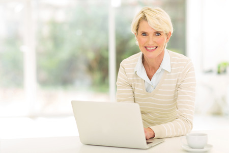 cheerful senior woman using computer photo