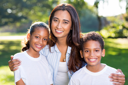 indian summer: beautiful young indian woman with her children outdoors