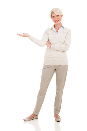 senior woman welcome gesture on white background