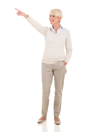 beautiful middle aged woman: beautiful middle aged woman pointing at empty copy space Stock Photo