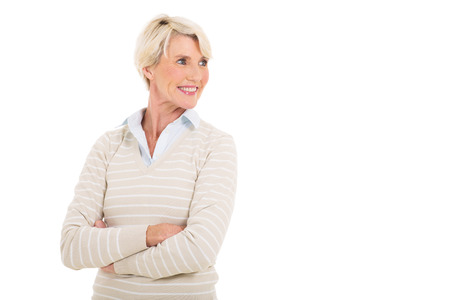 happy mature woman with arms crossed looking away photo