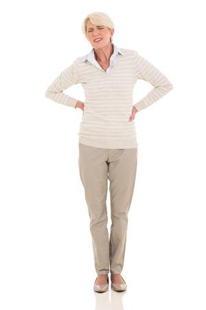 middle aged woman having back pain isolated on white background photo