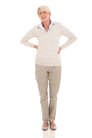 middle aged woman having back pain isolated on white background Stock Photo