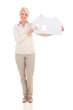 portrait of happy middle age woman holding paper house photo