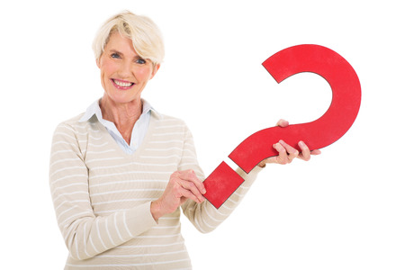 gorgeous middle aged woman with question mark symbol isolated on white photo
