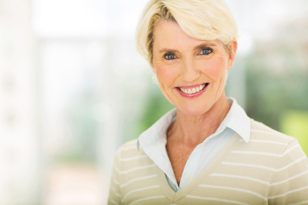 relaxed woman: elegant middle aged woman closeup portrait Stock Photo