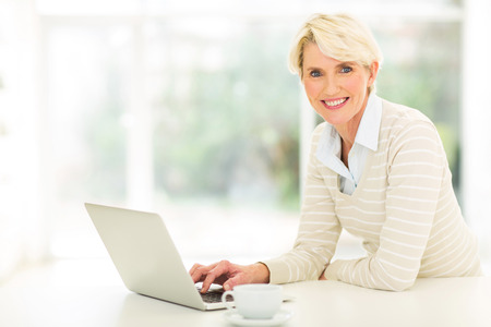 beautiful middle aged woman using computer  Stock Photo