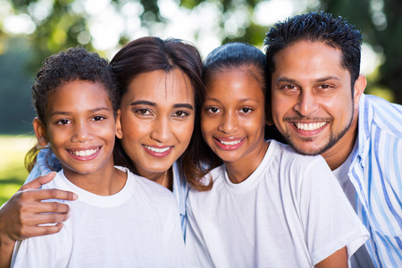 beautiful young indian family portrait outdoors photo