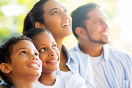 lifestyle looking lovely: happy indian family outdoors looking up Stock Photo