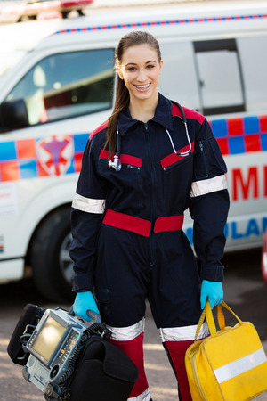 emt: attractive female paramedic holding portable devices