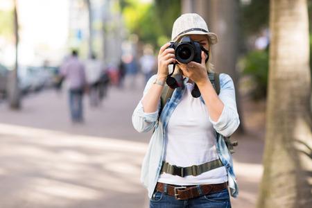 tourist taking street photos in the city photo
