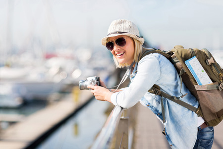 adventure holiday: gorgeous young female traveller at the harbour Stock Photo