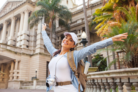 happy tourist posing in front of an historical building photo