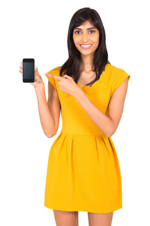 happy indian woman pointing at smart phone isolated on white photo