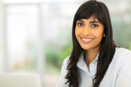 close up woman: portrait of pretty indian businesswoman in office Stock Photo