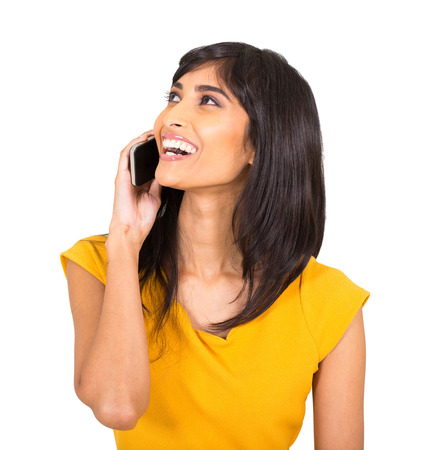 cheerful indian woman talking on cell phone photo