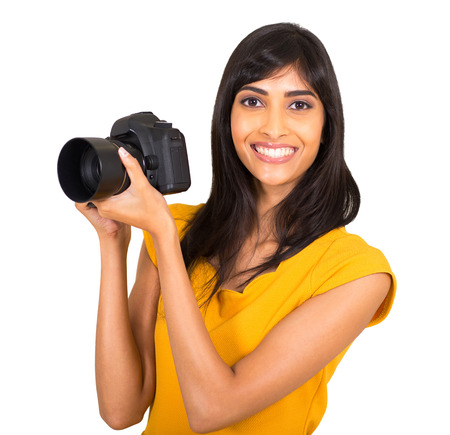 happy indian female photographer with a dslr camera photo