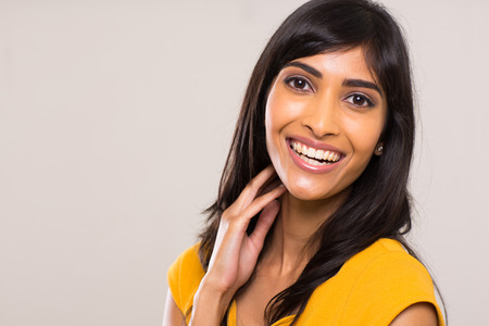 plain background: cheerful young indian woman on plain background Stock Photo