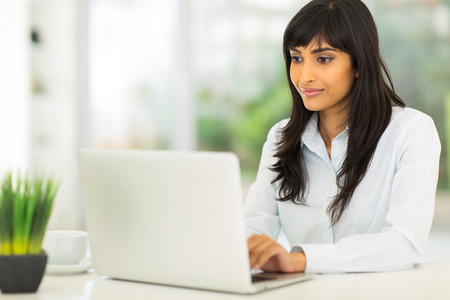 indian people: pretty indian businesswoman using computer in office Stock Photo