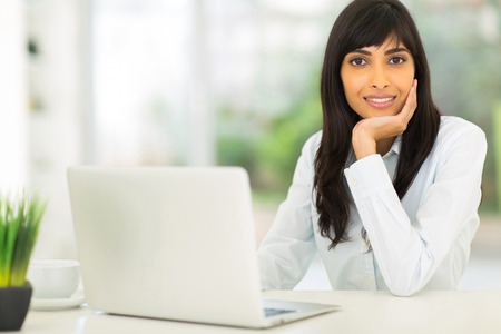 attractive young indian businesswoman in modern office photo