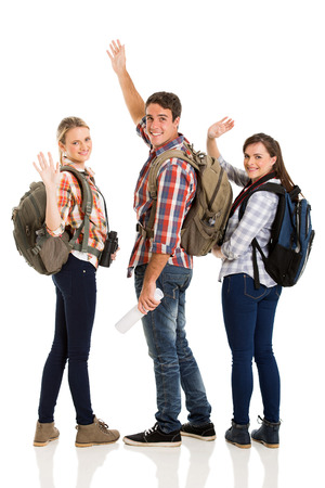 group of cheerful young tourists waving goodbye isolated on white