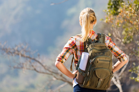 hiker: young female hiker standing on top of the mountain Stock Photo