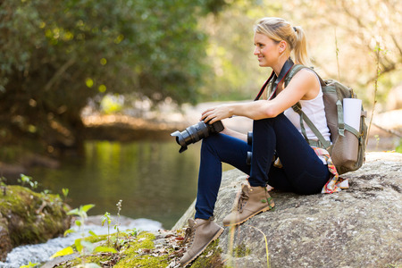 female photographer: young female photographer resting in mountain valley Stock Photo