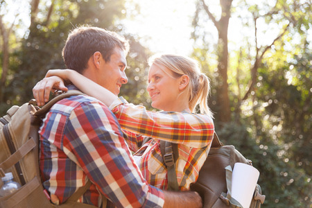 young hiker couple hugging in the mountain photo