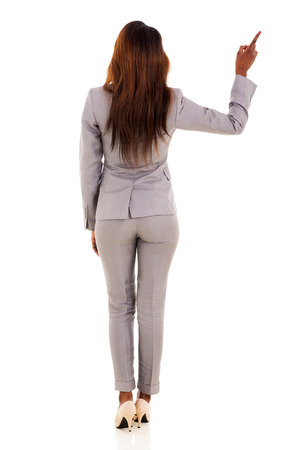 point of view: rear view of african american businesswoman pointing empty copy space