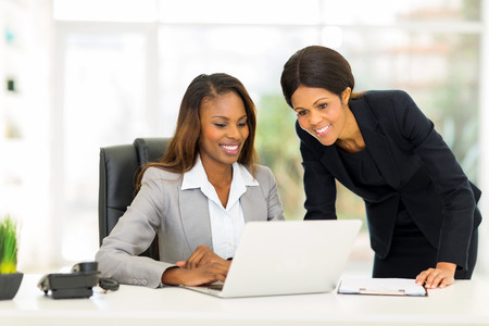 happy african female colleagues working in office Stok Fotoğraf