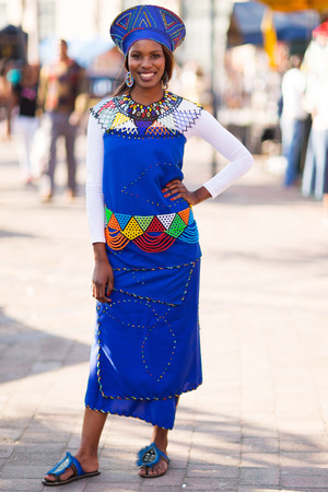 ethnic attire: beautiful african woman in traditional attire in the city Stock Photo