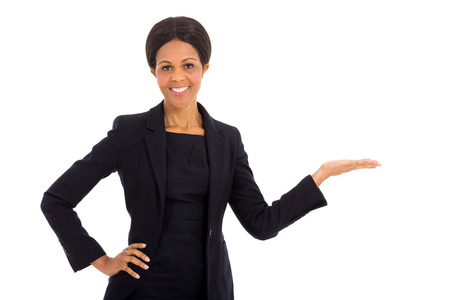 african american woman business: pretty middle aged african businesswoman presenting on white background Stock Photo