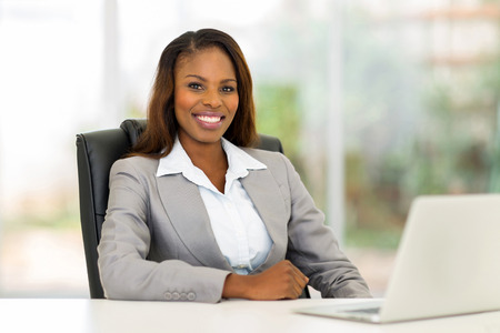 charming business lady: happy african american businesswoman in modern office