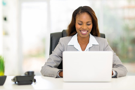 pretty afro american businesswoman using laptop computer