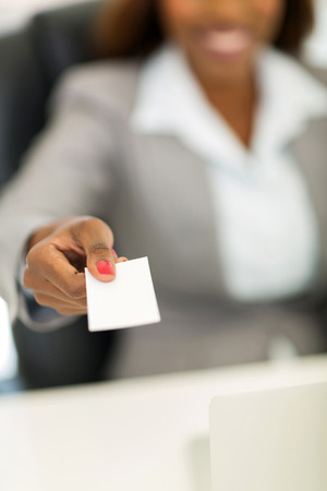 african american businesswoman handing business card photo
