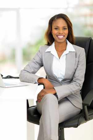 attractive african female business executive in modern office 스톡 콘텐츠