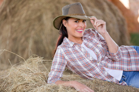 bale: portrait of beautiful country girl posing on hay