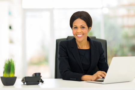 attractive mature afro american business woman using computer in office photo