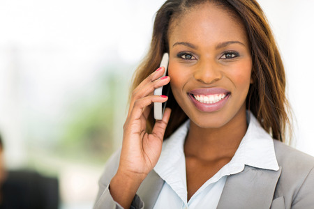 portrait of gorgeous black businesswoman talking on mobile phone photo
