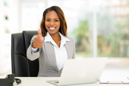 sit up: cheerful young african businesswoman giving thumb up